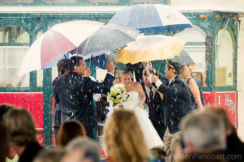 Rainy wedding ceremony at the beach
